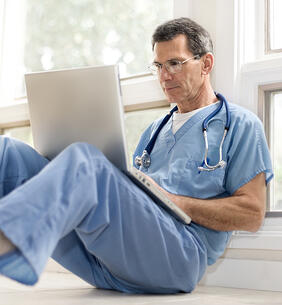 Doctor-Reviewing-Files-On-Hosted-Desktop